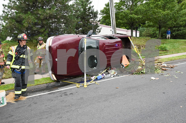 072417 Wesley Bunnell | Staff Emergency crews responded to a pick up truck rollover on Mountain Rd in Bristol on Monday afternoon.