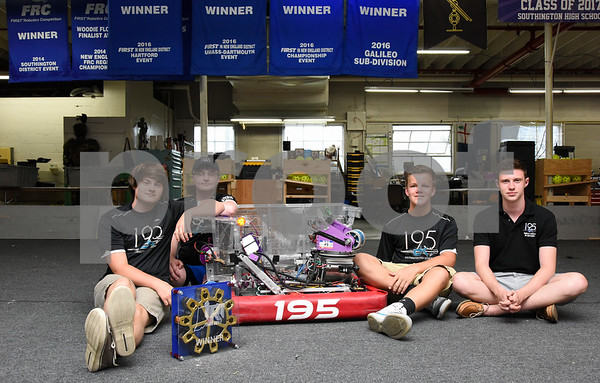 072417 Wesley Bunnell | Staff Members of the Cyber Knights, Southington High School's robotics team, pose with their trophy from their recent victory. Andrew Bauer, L, Stephen Rutkowski, Ryan Monte and Chris Bonomi.