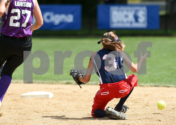 072617 Wesley Bunnell | Staff New York defeated Pennsylvania in a 2017 Little League Softball Eastern Regional Tournament game on Wednesday afternoon. Pennsylvania's Ella Visco is unable to get a handle on the ball.
