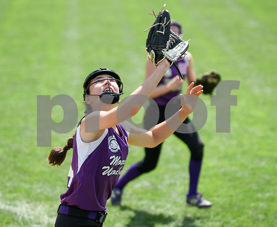 072617 Wesley Bunnell | Staff New York defeated Pennsylvania in a 2017 Little League Softball Eastern Regional Tournament game on Wednesday afternoon. New York first baseman Amanda Palmer (22) chases a foul ball.
