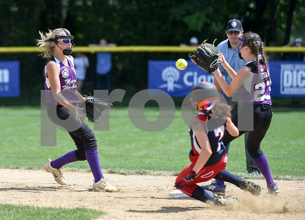 072617 Wesley Bunnell | Staff New York defeated Pennsylvania in a 2017 Little League Softball Eastern Regional Tournament game on Wednesday afternoon. Kelsey O'Brien (1) feeds second baseman Danielle Ryan (23) for the force to end the inning.