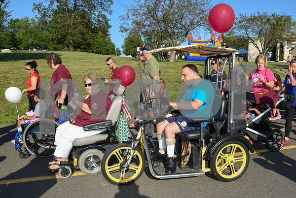 072617 Wesley Bunnell | Staff The 10th Annual Abilities/disabilities Walk and Roll celebrating the American Disabilities Act of 1980 took place on Wednesday evening at Walnut Hill Park. Participants at the beginning the lap around the park.