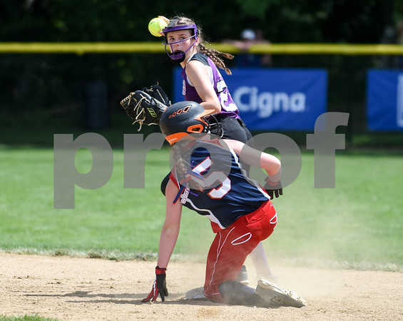 072617 Wesley Bunnell | Staff New York defeated Pennsylvania in a 2017 Little League Softball Eastern Regional Tournament game on Wednesday afternoon. New York's 2B Danielle Ryan (23) with the force on Pennsylvania's Katey Brennan (5).