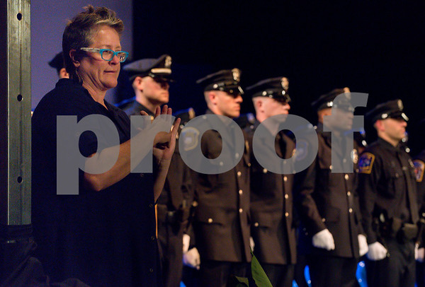 072717 Wesley Bunnell   Staff The 13th Training Session of the Regional Satellite Basic Recruit Academy graduated on Thursday afternoon at Trinity-on-Main in New Britain. A sign language interpreter on stage during the ceremony .
