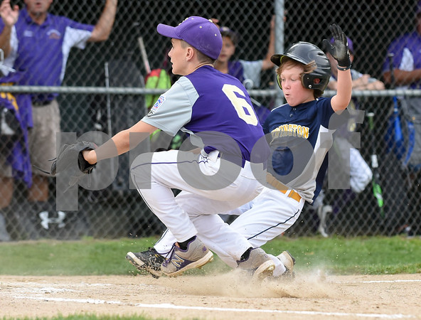 072817 Wesley Bunnell | Staff Newington vs Ellington in a Little League state finals game played at Adams Middle School in Guilford. Nick Gagliardi (1) slides safely into home.