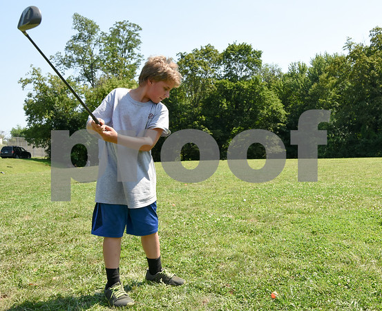 073117 Wesley Bunnell | Staff Jonathan Rose, age 12, practices his swing on Monday afternoon during golf class as part of the Extreme Summer Program. The program is through the New Britain Board of Education.