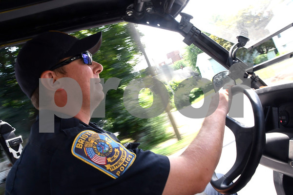 7/11/2017 Mike Orazzi | Staff Bristol police officer George Franek while on patrol in the police explorer's John Deere Gator Tuesday.