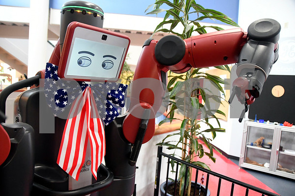 7/1/2017 Mike Orazzi | Staff Baxter the robot wearing some Fourth of July bunting at the Imagine Nation Museum Early Learning Center Saturday morning in Bristol during Patriotic Day & Lo's Sweet Treat Day.
