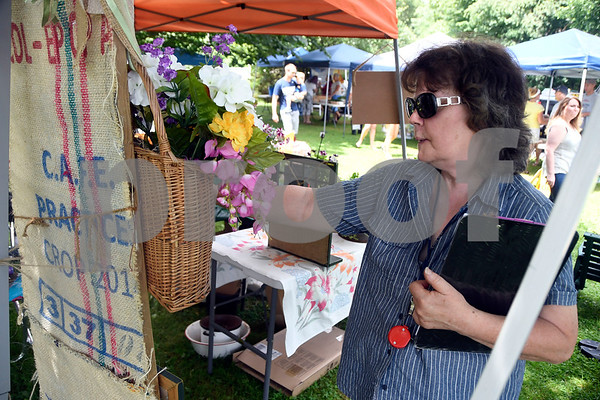 7/1/2017 Mike Orazzi | Staff The Artful Garden's Jane Georgini during the Farmer's Market held at New Britain Youth Museum At Hungerford Park Saturday morning.
