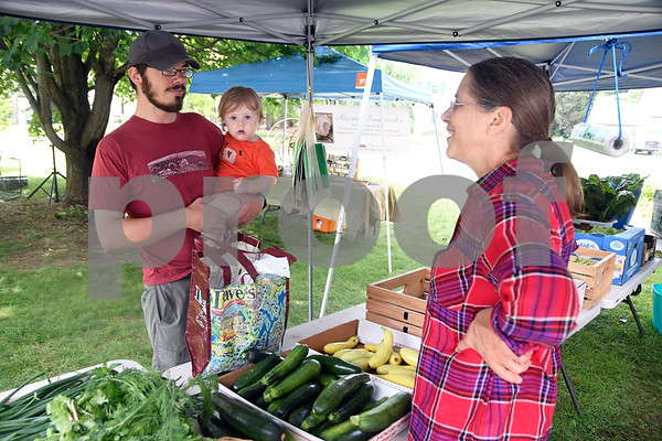 7/1/2017 Mike Orazzi | Staff Peter Van Sickler and his daughter Annie while purchasing fresh vegetables from Tina Berger during the Farmer's Market held at New Britain Youth Museum At Hungerford Park Saturday morning.