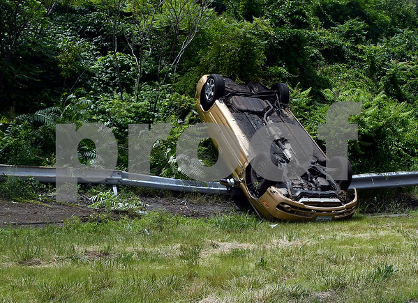 7/1/2017 Mike Orazzi | Staff The scene of a vehicle rollover on the Plainville New Britain town line on Route 72 Saturday afternoon.
