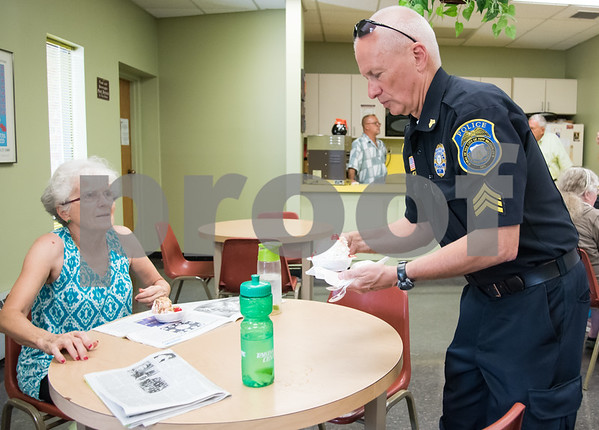 071217 Wesley Bunnell | Staff New Britain TRIAD served up ice cream at the New Britain Senior Center on Wednesday afternoon. New Britain Police Sgt. Art Powers serves Christine Guillette.