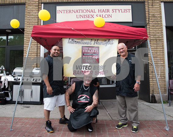 071217 Wesley Bunnell | Staff International Hair Stylist celebrated winning a Best Of award from the New Britain Herald on Wednesday afternoon. Javier Cruz, L, Herbie Holter Jr. & Herbert Holter Sr.