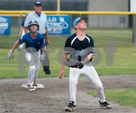 071217 Wesley Bunnell | Staff The Little League age 10-11 District 5 Championship game was played at Trumbull Park in Plainville featuring Southington North vs Wallingford. SS Kyle Crispens (11) watches a fly ball head towards left center.