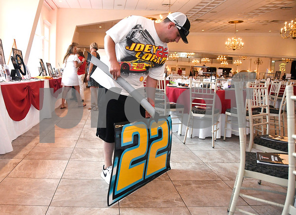 7/13/2017 Mike Orazzi | Staff Joey Logano fan Joe Piccolella with items to be signed at the Aqua Turf Club for Driving Hope Home, the annual Joey Logano Foundation charity event in Connecticut Thursday afternoon.