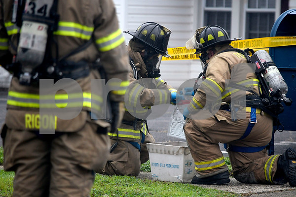 7/14/2017 Mike Orazzi | StaffPlymouth firefighters collect and seal a bag of white powder found in a U.S Postal Service mailbox on Agney Avenue behind Thomaston Savings Bank Friday afternoon. The street was closed for several hours as state DEEP officials, Plymouth Police and Fire along with a regional postal inspector responding to the scene.