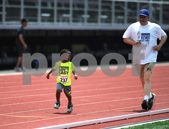 7/15/2017 Mike Orazzi | Staff Elliott Johnson (237) gets some help running the 400 meter during the Nutmeg Games held in Willow Brook Park in New Britain Saturday.