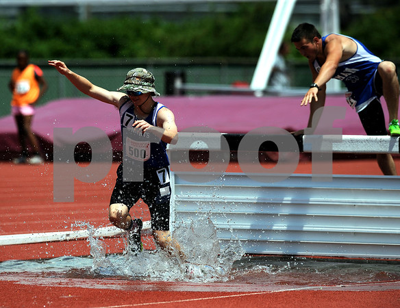 7/15/2017 Mike Orazzi | Staff Ryan Slesinski in the 2000 meter steeplechase during the Nutmeg Games held in Willow Brook Park in New Britain Saturday.