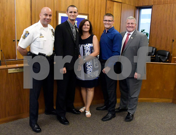 7/6/2017 Mike Orazzi   Staff Future Bristol police officer John D. Clary after taking the oath to become a Bristol police officer during a ceremony at city hall Thursday afternoon. Left to right, chief Brian Gould, Clary, his mom Alisa, twin brother Adam and Bristol Mayor Ken Cockayne.
