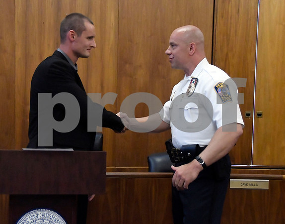 7/6/2017 Mike Orazzi   Staff Future Bristol police officer John D. Clary shakes hands with police chief Brian Gould after taking the oath to become a Bristol police officer during a ceremony at city hall Thursday afternoon