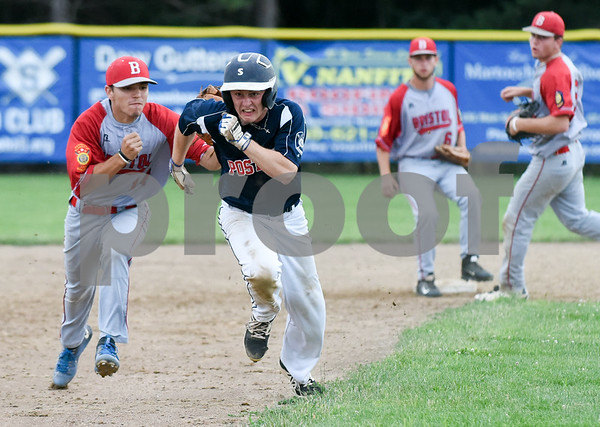 070617 Wesley Bunnell   Staff Southington vs Bristol in American Legion Baseball on Thursday evening at Southington High School. Alec DiLoreto (14) tags Daniel Topper (6) on a rundown after Topper was caught off second base.