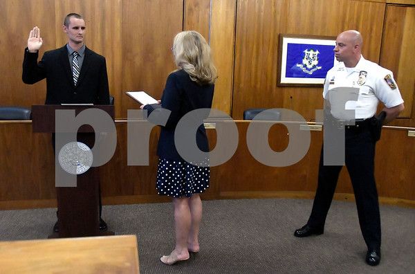 7/6/2017 Mike Orazzi | Staff Future Bristol police officer John D. Clary takes the oath to become a Bristol police officer during a ceremony at city hall Thursday afternoon.