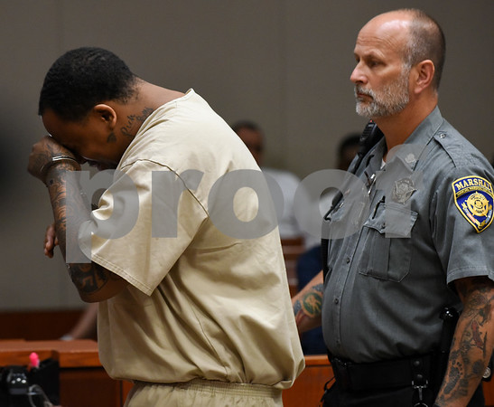 070617 Wesley Bunnell | Staff Rahheem K. McDonald, 38, or Waterbury was arraigned in New Britain Superior Court on Thursday in connection with the murder of a motel clerk Pratikkumar Jagani in Berlin on Sunday. McDonald breaks down as he prepares to exit court.