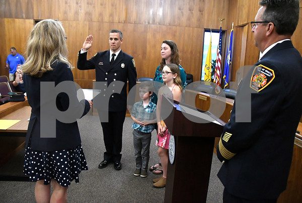 7/6/2017 Mike Orazzi   Staff Bristol Fire Department's Todd Correll takes the oath of office during his promotion to fire captain at Bristol City Hall Thursday.