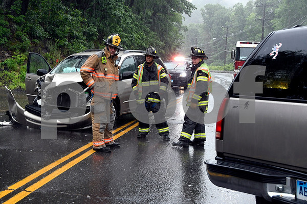 7/7/2017 Mike Orazzi | Staff The scene of a two car head on crash on Terryville Road near Ross Auto Parts. One was transported by ambulance.