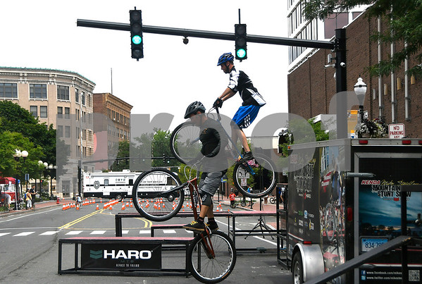 7/8/2017 Mike Orazzi | Staff Mike Steidley and Joe Janicki perform stunts on their bikes during the 4th Annual Bike Safety Day in downtown New Britain Saturday.