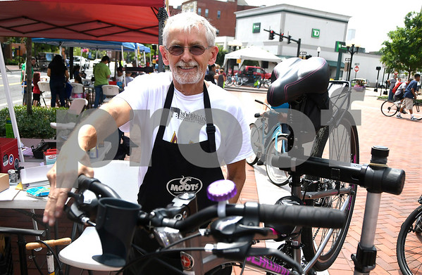 7/8/2017 Mike Orazzi | Staff Bruce Miller performs a safety check on a bike during the 4th Annual Bike Safety Day in downtown New Britain Saturday.