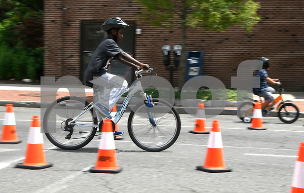 7/8/2017 Mike Orazzi | Staff Noah Cabrera,11, rides through the obstacle course during the 4th Annual Bike Safety Day in downtown New Britain Saturday.