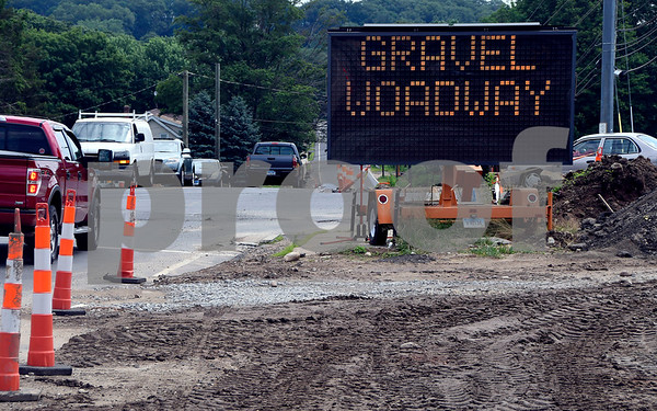 7/8/2017 Mike Orazzi | Staff The road sign at the intersection of Route 69 and Peacedale Street and Maple Avenue Saturday.