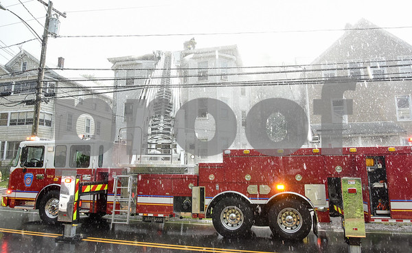 062717 Wesley Bunnell | Staff A fire broke out Tuesday afternoon at 404 East St in New Britain on the top floor. Heavy rain broke out during parts of the fire.