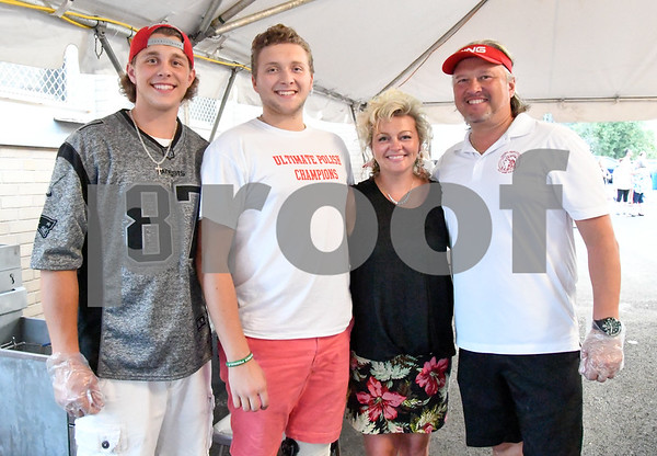 062317 Wesley Bunnell | Staff The Wiecki family volunteered to work the food tent at the Sacred Heart Festival on Friday June 23. Sons Darek, L, & Paul pose for a photo with mom Lisa and dad Robert.