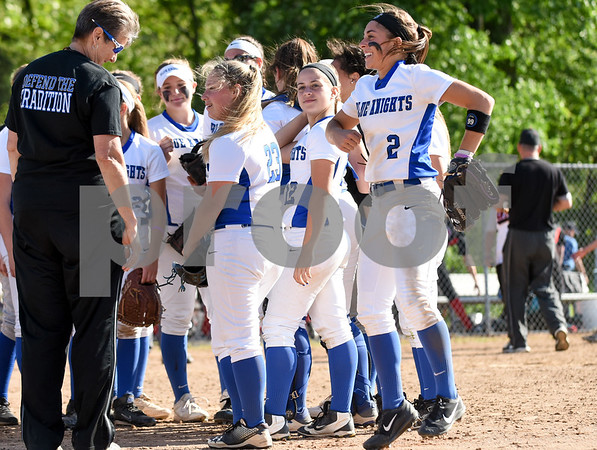 060217 Wesley Bunnell | Staff Southington High softball defeated E.O. Smith in a quarterfinal game on Friday afternoon. Michelle Woodruff (2) jumps as she exits the field after tagging the E.O. Smith runner out at second base to end the inning.