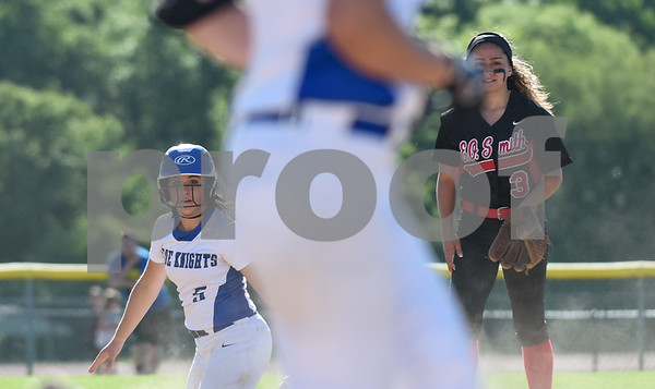 060217 Wesley Bunnell | Staff Southington High softball defeated E.O. Smith in a quarterfinal game on Friday afternoon. Frankie Ferrante (5) and Allyson Petrella (3) watch the second half of the play unfold at first base.