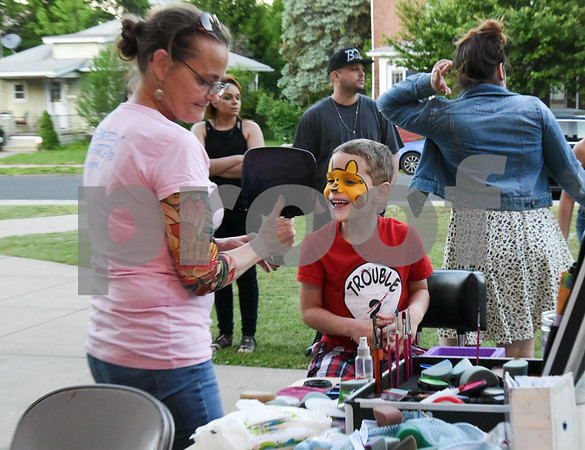 060217 Wesley Bunnell | Staff Vance Village School held their second annual End of Year Celebration on Friday evening featuring inflatables , face painting & glitter tattoos, cotton candy and a magician. Ty Gagliardi, age 6, smiles as he examines the Pikachu character painted on his face.