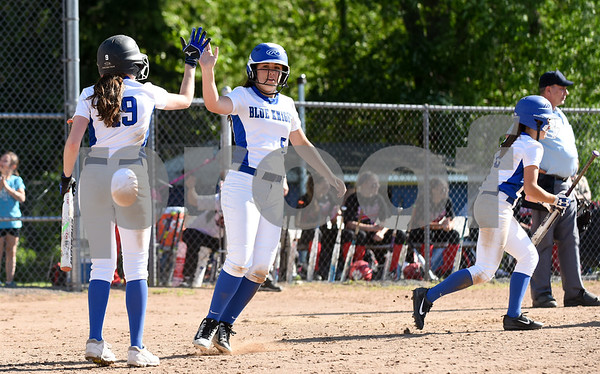 060217 Wesley Bunnell | Staff Southington High softball defeated E.O. Smith in a quarterfinal game on Friday afternoon. Sarah Myrick (19) congratulates Frankie Ferrante (5) after Ferrante scores a run.
