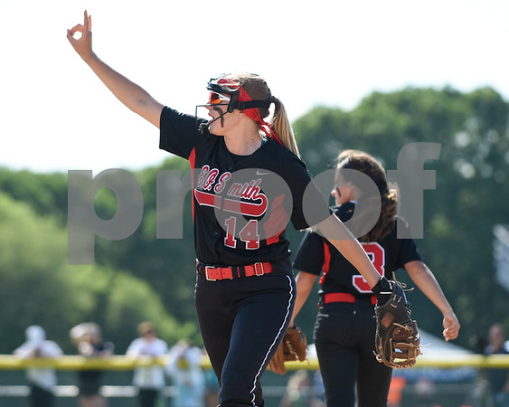 060217 Wesley Bunnell | Staff Southington High softball defeated E.O. Smith in a quarterfinal game on Friday afternoon. E.O. Smith's Christine Guyette (14) motions two outs to teammates.