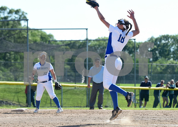 060217 Wesley Bunnell | Staff Southington High softball defeated E.O. Smith in a quarterfinal game on Friday afternoon. Pitcher Kara Zazzaro (18) makes the play on a hard hit ball back up the middle and throws to first for the out.