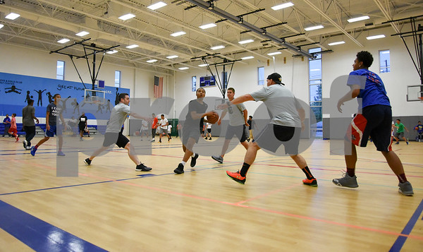 060517 Wesley Bunnell   Staff Bristol Police took part with area youth in a 3 on 3 basketball tournament at the Bristol Boys & Girls Club on Monday evening. The event was designed to show area children the community cares about them and wants them to succeed.