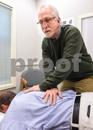 060517 Wesley Bunnell | Staff Dr. Stuart Horen from Horen Chiropractic giving a patient an adjustment.