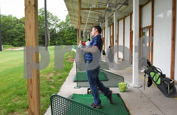 060517 Wesley Bunnell | Staff Steve Mastin works on his irons at the Stanley Golf Course Driving Range on Monday evening.
