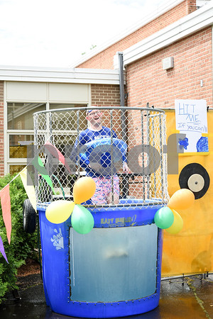 060917 Wesley Bunnell | Staff Bristol Eastern High School held its second annual SAT Carnival on Friday. The carnival featured face painting, cotton candy, pie throwing, duct taping, and a dunk tank for Juniors who took the SAT's. Assistant Principal Mike Higgins drops into the dunk tank.