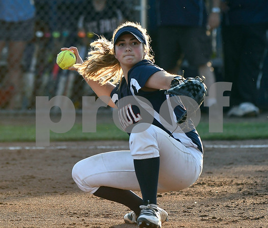 6/9/2017 Mike Orazzi | Staff St. Paul Catholic's Alessandra Milardo (11) fields a bunt during a loss to Holy Cross during the Class S Final held at West Haven High School Friday night.