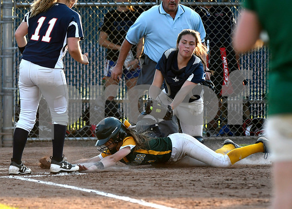 6/9/2017 Mike Orazzi | Staff Holy Cross' Allie Brown (1) tagged out at home by St. Paul's Lindsey O'Bright (32) during the Class S Final held at West Haven High School Friday night.