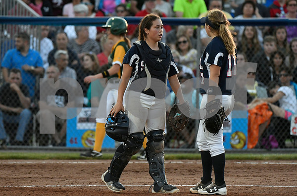 6/9/2017 Mike Orazzi | Staff St. Paul Catholic's Lindsey O'Bright (32) and Alessandra Milardo (11) during a loss to Holy Cross during the Class S Final held at West Haven High School Friday night.