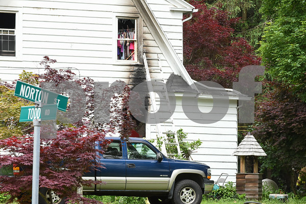 060917 Wesley Bunnell | Staff Fire damaged a home on Todd Rd in Southington near the intersection with Norton St on Friday morning.