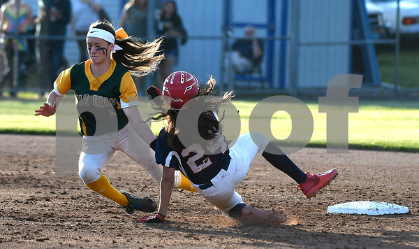 6/9/2017 Mike Orazzi   Staff Holy Cross' Allie Brown (1) as St. Paul's Janessa Gonzalez (24) slides safely into second during the Class S Final held at West Haven High School Friday night.